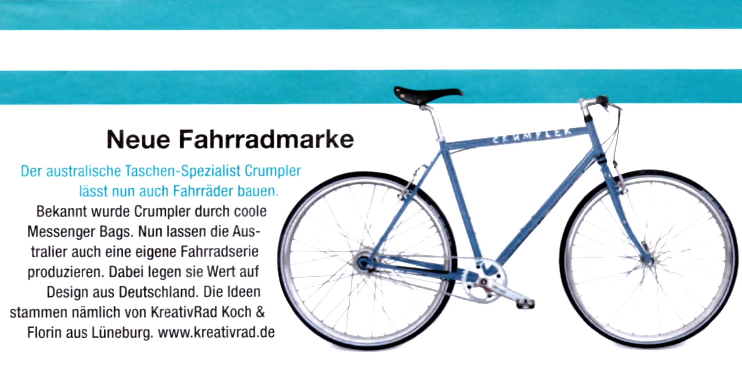 """Artikel über die Kooperation der Firma Crumpler und KreativRad """"Neue Fahrradmarke"""". Zu sehen ist ein blaues Crossbike mit dem Firmenschriftzug der Firma Crumpler. Das Crumpler Corporate Bike."""