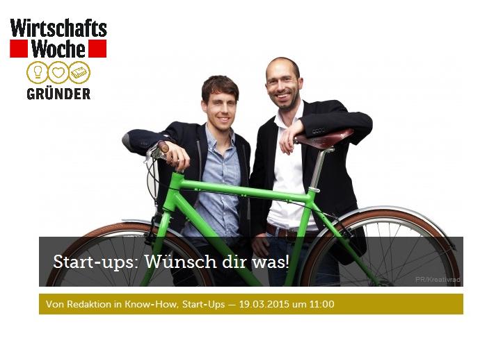 KreativRad Gründer Christoph Florin und Christoph Koch im Vordergund ein grünes Fahrrad mit Brooks Sattel und Griffe in braun