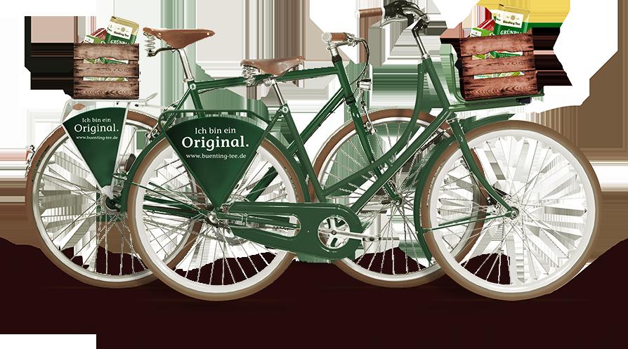 zwei grüne Firmenfahrräder mit Holzkisten als Körbe die Fahrräder tragen die aufschrift Bünting Tee