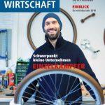 Christoph Florin im IHK-Magazin Unsere Wirtschaftirtschaft. Christoph Florin ist auf dem Titelbild zu sehen. Ein Mann in der Fahrradwerkstatt mit blauer Mütze und einem Fahrrad Laufrad in der Hand.